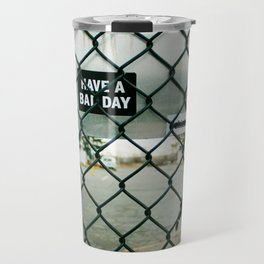 Behind a skate park fence Travel Mug