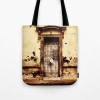 merida Tote Bags featuring Merida Puerta by Ken Seligson