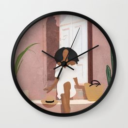 Woman sitting on the porch Wall Clock