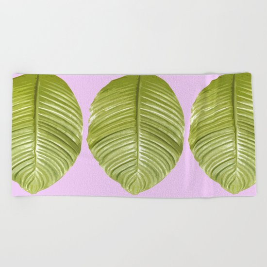 Three large green leaves on a pink background - vivid colors Beach Towel