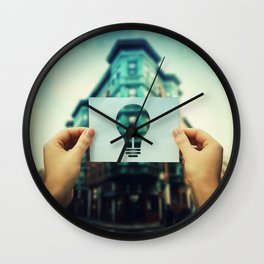 holding bulb icon Wall Clock