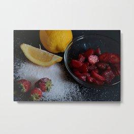 Bowl of strawberries with lemon and sugar on black board. Metal Print