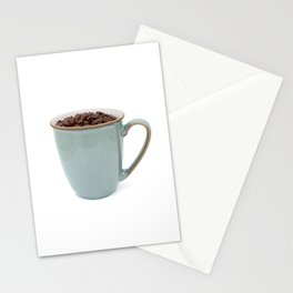 Turquoise mug of aromatic coffee beans Stationery Cards