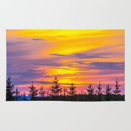 Sunset above the forest Rug