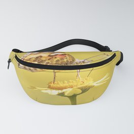 Orange butterfly feeding on yellow marigolds Fanny Pack