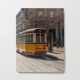 A yellow tram passes through the streets of the city of Milan Metal Print