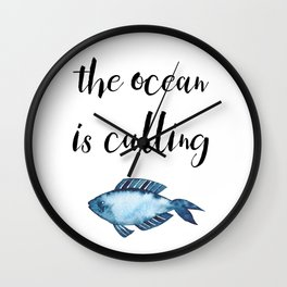 The ocean is calling / blue fish watercolor Wall Clock