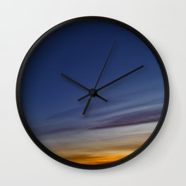 Bright colors of the twilight sky Wall Clock