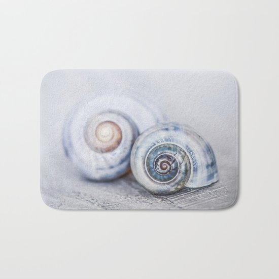 Blue Shells on white washed wood in soft pastel blues Bath Mat