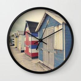 Damaged huts Wall Clock