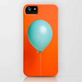 Teal balloon on orange backdrop iPhone Case