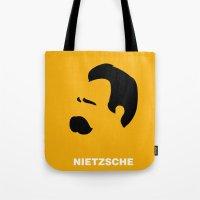 nietzsche Tote Bags featuring NIETZSCHE by eve orea