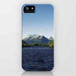 Deep blue mountainous sunset iPhone Case