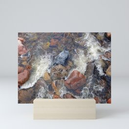 River rocks and rushing water Mini Art Print