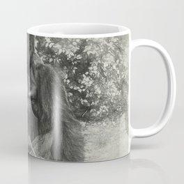 Male gorilla sitting on the ground Coffee Mug