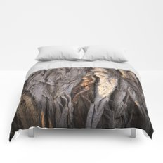 Abstract Human Figures in Gnarled Wood and White Cinder Block Comforters