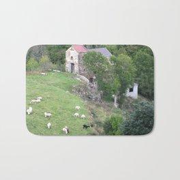 Goats herding next to castel Bath Mat