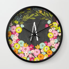 A botanical monogram. Letter initial with colorful flowers on a chalkboard background Wall Clock
