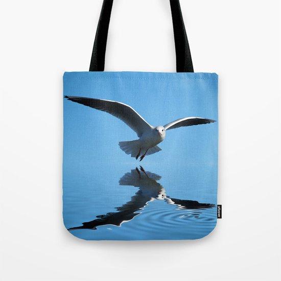 Seagull on blue sky Tote Bag
