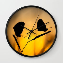 Silhouette of moths Wall Clock