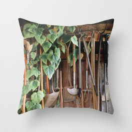 Hedera Ivy growing among gardening tools in a shed. UK. (Shot on film). Throw Pillow