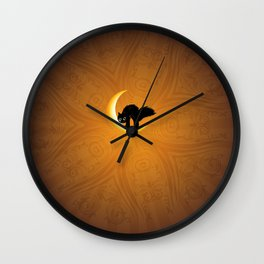 Black kitten on crescent moon Wall Clock