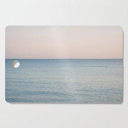 PINK SKY, BLUE SEA, EVENING SWIM Cutting Board