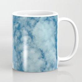 Fluffy clouds in a blue sky Coffee Mug