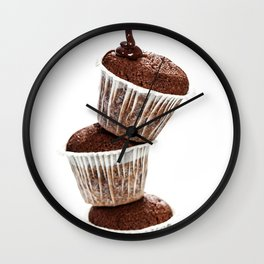 muffins with chocolate sauce over white Wall Clock