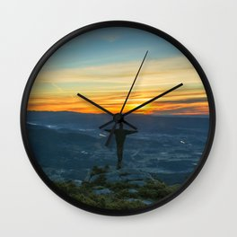 Beautiful landscape with a man on the top of a mountain at sunrise Wall Clock