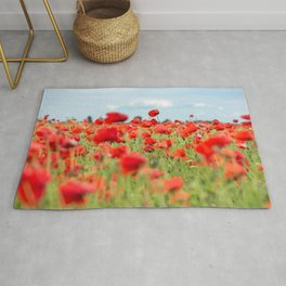 Field with red papavers Rug