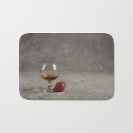 Strawberry and Brandy on a Mottled Grey Background Bath Mat