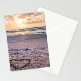 Love note Te Amo with the heart drawing on the beach at sunrise Stationery Cards