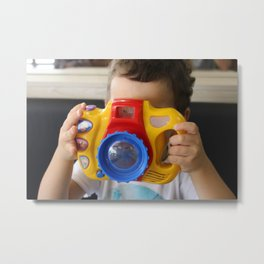 A boy taking photos with a toy camera. Metal Print