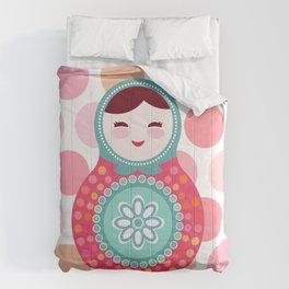doll matryoshka, pink and blue, pink polka dot background Comforters