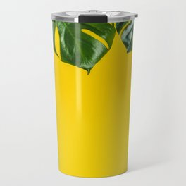 Tropical leaves on yellow background, space for text Travel Mug