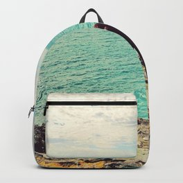 Girl looking out to sea Backpack