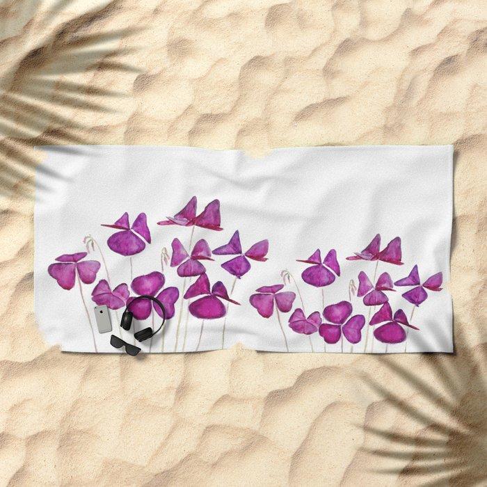 purple clover leaves Beach Towel