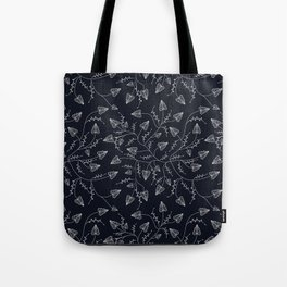 Delicate leaves on a black background . Tote Bag