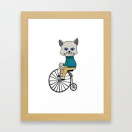The cat on bicycle Framed Art Print