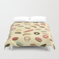 macaroons Duvet Covers featuring Pastry by Julia Badeeva