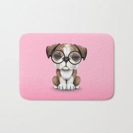 Cute English Bulldog Puppy Wearing Glasses on Pink Bath Mat