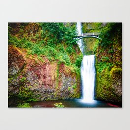Bridge over waterfall full with green leaves and water pool Canvas Print