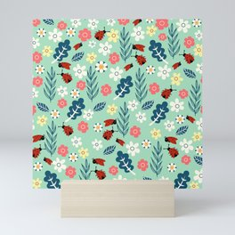 Spring meadow in bloom with ladybirds on green background Mini Art Print