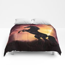 Rearing black horse at sunset Comforters