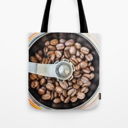 Roasted coffee beans in a manual coffee grinder. The view from the top. Tote Bag