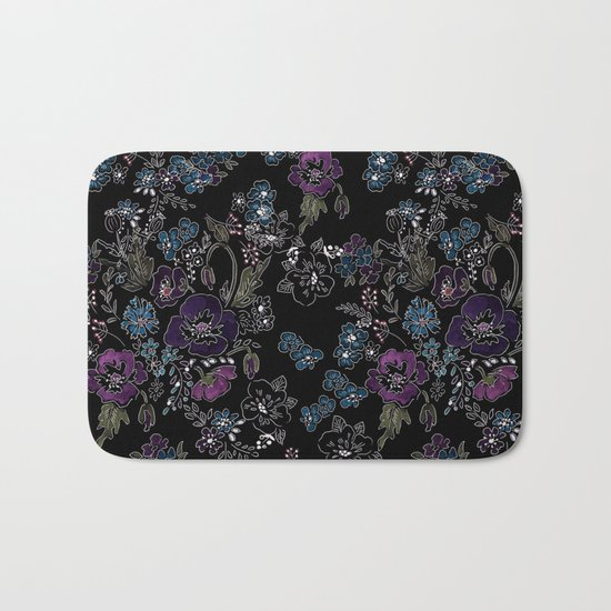 Floral pattern on a black background . Blue and purple flowers . Bath Mat