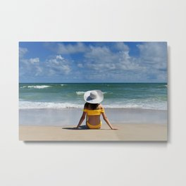 Female in yellow bikini wearing a white floppy hat sitting on ocean beach Metal Print