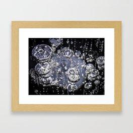 Air bubbles in frozen water Framed Art Print