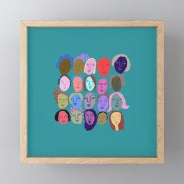 Faces in teal Framed Mini Art Print